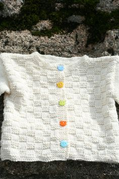 Free Pattern in English. Gratis mönster på svenska. Youtube video. A knitted cardigan without any seams for a baby 3-6 months. Yarn and knitting needles: Drops Merino Fine and knitting needles 3 mm…