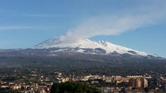 Etna snow and eruption