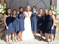 All the bridesmaids have navy dresses in different styles