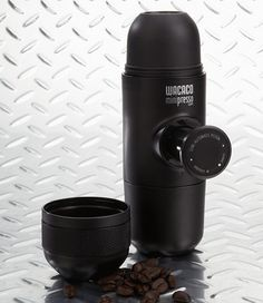 """Title Nine: Minipresso Portable Espresso Maker - Rejoice, caffeinators: you can now have your creamy-headed, hot cuppa wherever you roam. Tested and approved by the coffee hounds at T9HQ, this press is smaller than our favorite reusable water bottle, weighs less than a pound, and makes espresso in three easy, bleary-eyed steps. Add grounds, hot water, then push the piston. Attached scoop, cup. 7""""x2"""