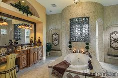 Master bathroom design creates his and her spaces