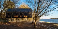 Located in Progar Ada, Serbia, this Small River House, designed by Remorker Architects in is an house, used as a vacation home. Black Architecture, Flooded House, Contemporary Cabin, Modern Barn House, Gate House, Mountain Homes, River House, House And Home Magazine, My Dream Home