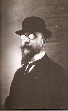 """This is Erik Satie. His music is rather experimental, and I don't know what to make of a lot of it. But I do like """"Gymnopedies"""", """"Gnossienes"""", and """"Sarabandes"""", and I'm trying at the moment (in vain!) to play """"Embryons Desechees"""" no. 1 (I know, quite an odd name)."""