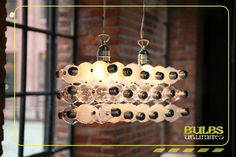 Designer light fixtures made from common recycled light bulbs -- http://www.bulbs-unlimited.com/home_en.htm