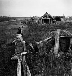 whatawildadventure:UKRAINE. 1947. Girl sitting on wooden fence on a collective farm, photo by Robert Capa