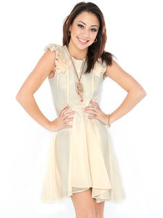 Confused about dress to wear to a wedding - buy avMatilda Ruffle Mini Dress In Cream. Skirt is full and flares out at the waist creating a gorgeous silhouette.