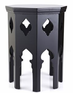 Octagonal Pasha Table by Martyn Lawrence Bullard / These small and useful tables have a romantic pierced workmanship that's both simple and elegant, yet its contours mimic a moorish look.