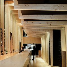 ribbed timber framework folds around the walls and ceiling of this bar in Porto by Portuguese studio AVA Architects.