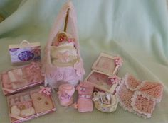 Dolls House Miniature OOAK Baby Crib, OOAK baby Sculpture and Gift Set. £50.00, via Etsy.