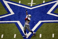 Dallas Cowboys running back Emmitt Smith celebrates setting the all-time career rushing record in the game against the Seattle Seahawks in Irving, Texas, Sunday, Oct. 27, 2002. Smith broke the record with an 11-yard run in the fourth quarter. (Irwin Thompson/Staff Photographer)
