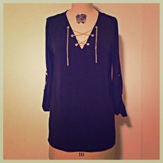"Michael Kors Tunic Gold Chain Worn a couple times and always received compliments! Michael Kors navy tunic with gold chain yolk. Measures about 27 1/2"" from shoulder to hem, about 20"" across the chest when flat, and has a 20"" sleeve length when rolled. Gold tone hardware. Poly spandex blend. Soft and great all year around fabric. Marked petite M, but would fit regular M too. tradesPP. Michael Kors Tops Blouses"