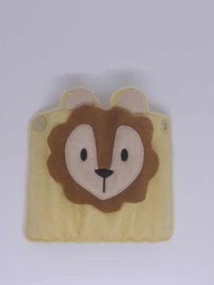 These cute handmade lion pencil wraps come with 9 mini colouring pencils. They can be personalised with the name embroidered on the front and fasten at the back with a snap fastener.