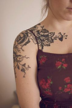 flower tattoo-not so far onto the collar bone though.