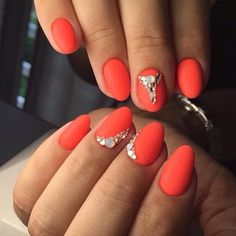 Almond-shaped coral Matte nails by shellac