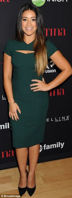 Green goddess: Gina Rodriguez looked lovely in a form-fitting green dress and black pumps...
