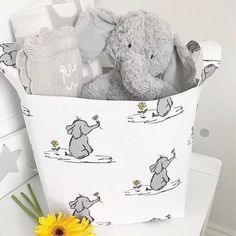 Beautiful baby elephants storage baskets available in a range of colours and sizes. All handmade to order. Matching cot bedding and blankets also available on request. Elephant Baby Decor, Elephant Nursery Boy, Elephant Theme, Safari Nursery, Baby Elephants, Animal Nursery, Baby Shower Registry, Baby Shower Gifts, Baby Gifts