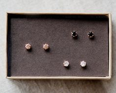 Trio of earrings: white, black and blush.