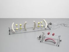 "View of ""Phantom Limbs,"" Pilar Corrias, London, 2014. (Left) Antoine Catala, (::( )::) (band aid), 2014. Steel, plastic-coated polystyrene, motor, electronics, and power supply, 27.9 x 121.9 x 30.5 cm. (Right) Antoine Catala, :), 2014. Steel, plastic-coated polystyrene, rubber-coated, 3D-printed ABS plastic, motor, electronics, and power supply, 27.5 x 50.8 x 30.5 cm. Image courtesy of Pilar Corrias, London."