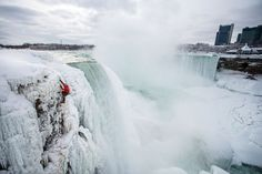 Ice climber Will Gadd nears the top after scaling Niagara Falls on January 27, 2015. Gadd and Sarah Hueniken became the first people to reverse the usual trip down the falls by ascending a 30-foot-wide area of spray ice that formed along the left edge of Horseshoe Falls, which rises 150 feet. © Christian Pondella/Red Bull/SI/REX Features