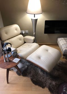 Paul Sykes spent time living in Denmark so has recreated that Danish interior style, as you can see in the pic above, featuring the Danish lamps and one of our sheepskins. He says one of his cats blends beautifully into the large fleece! Danish Interior, Interior Styling, Denmark, Lamps, Ottoman, Fan, Furniture, Home Decor, Style