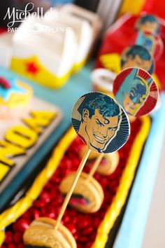 SO EASY & cute! Stick toppers into the sides of cookies! Superhero Party with So Many Awesome Ideas via Kara's Party Ideas | KarasPartyIdeas.com #Superhero #Party #Ideas #Supplies  #wonderwoman