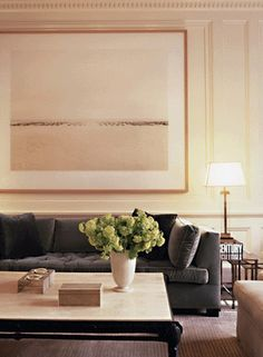 grey velvet sofa, giant framed art