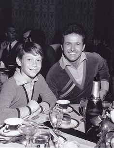 A behind the scenes shot of TV cult stars' Billy Mumy and Mark Goddard enjoying a meal break during filming of the popular 1960s TV adventure series, LOST IN SPACE!