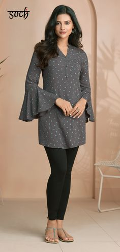 This alluring grey cotton straight cut tunic will have you raising the bar of contemporary elegance. This alluring grey cotton straight cut tunic will have you raising the bar of contemporary elegance. Tunic Designs, Kurti Neck Designs, Kurta Designs Women, Kurti Designs Party Wear, Ladies Frock Design, Simple Kurti Designs, Sleeves Designs For Dresses, Indian Designer Wear, Stylish Dresses