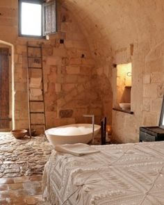 Romantic candlelit rooms are carved out of rock at this stunning cave hotel in Sassi di Matera | Sextantio Le Grotte in Matera, #Italy - Jetsetter