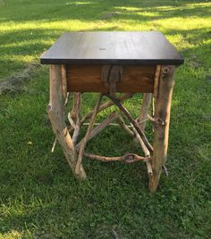 This rustic table would look great in any Adirondack style home , with its dark stained top ,drift wood legs and Stick work .
