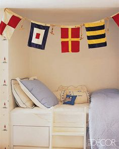 A fun twist on personalized art in a kid's room: using signal flags to spell out a child's name. #NauticalJuly