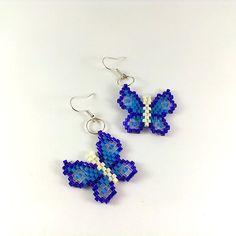 Mooie kralen oorbellen in de vorm van vlinders. Blauw - violet - wit - transparant. Oorbellen zijn gemaakt zeer zorgvuldig en nauwkeurig voor Japanese kralen Delica.  Totale lengte: 5,2 cm (2 inch) Lengte van earring: 2,5 cm (1 inch) Breedte van earring: 2,8 cm (1.1 inch)  Neem contact met me op als u zou willen hebben verschillende kleuren.  Ik stel voor dat je kijkt naar mijn andere creaties https://www.etsy.com/ru/shop/Galiga  Ik stel voor dat je kijkt naar het soo...