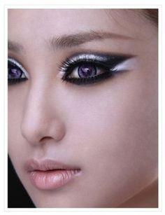 Dramatic black and white eye makeup. Futuristic sci-fi wedding inspiration.