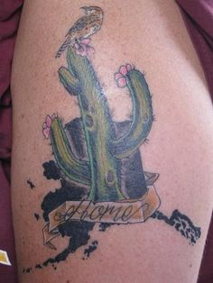 """My 2nd tattoo showing a saguaro cactus with cactus wren on top of a blacked out state of Alaska outline. The banner says """"Home"""" as I feel at home in both Arizona and Alaska."""