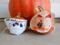 This is what we do with pumpkins before carving day... Pumpkin masks