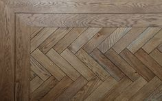 herringbone flooring A herringbone design parquet floor - here shown with a double border Material: Oak, stained and oiled Wood Floor Design, Wood Floor Pattern, Herringbone Wood Floor, Floor Patterns, Herringbone Laminate Flooring, Hall Flooring, Wooden Flooring, Hardwood Floors, Oak Parquet Flooring