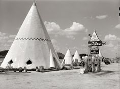 "July 1940 ""Cabins imitating the Indian teepee for tourists along highway south of Bardstown, Kentucky. (Wigwam Village #2, Cave City)."" Photo by Marion Post Wolcott for the Resettlement Administration."