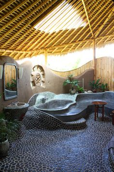 natural stone and cob bathroom - Accommodation consists of three uniquely designed grass roof cottages crafted by combining local skills with western detail.