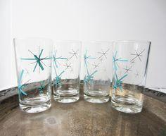 Four Vintage Retro Turquoise & Black Atomic Starburst Tumblers Glasses. $24.00, via Etsy.