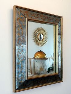 French verre eglomise mirror in gilded wooden frame c.1950's.Eglomised glass is glass engraved on the back that has been covered by unfired painting or, usually, gold or silver leaf.