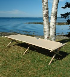 The Maine Heritage Cot, with a classic look of wood and canvas.