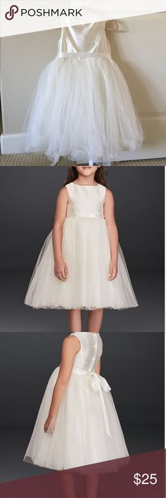 Like new David's Bridal Flower Girl dress size 6 Perfect condition, worn for one wedding by my daughters. I have a size 5 and a size 6. They run pretty true to size. My 4 year old is tall and wore the size 5, my 7 year old is thin and wore the size 6. Color is a light ivory, closer to white than cream but not stark white. Absolutely adorable tulle and girls said the dresses were very comfortable.  Would be a great church dress too. Tags cut because they were huge and itchy but this is 100%…