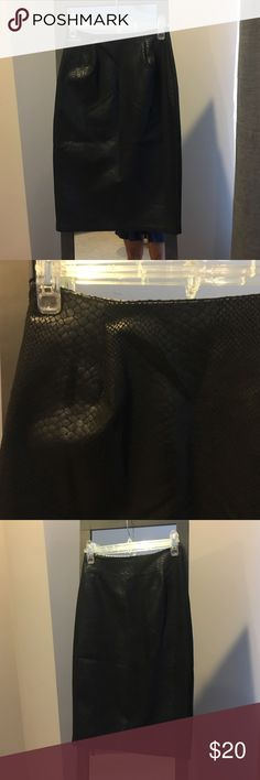 Black skirt Faux leather fitted skirt. Fits a size 00. Classy and timeless. AKIRA Skirts Pencil