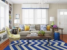 Whisper Gray + Cobalt Blue + Aqua + Yellow When dealing with a small living room, it's best to keep big pieces neutral. The gray sofa and neutral walls open up the room, and the pops of color in the rug and pillows add pizzazz.