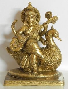 Goddess Saraswati Sitting on Swan (Brass) Saraswati Statue, Saraswati Goddess, Statue En Bronze, Brass Statues, Silver Pooja Items, Hindu Statues, Pooja Rooms, Hindu Deities, God Pictures