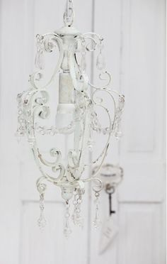 Chandelier and white washed walls.