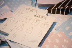 Fun Baby Shower Activity: Everyone makes a paper airplane, which is added to a mobile to live in the baby's nursery!