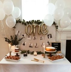 Smart idea to use a fabric bulletin board as the backdrop for the welcome table
