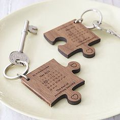 Again key chains for each Hal of the couple, but this one has a jigsaw piece with the date of the wedding on as to never forget, could also have a heart or a crown maybe - but I really like the date idea