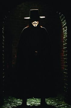 V, an anarchist revolutionary dressed in a Guy Fawkes mask, begins an elaborate, violent, and intentionally theatrical campaign to murder his former captors, bring down the government, and convince the people to rule themselves.